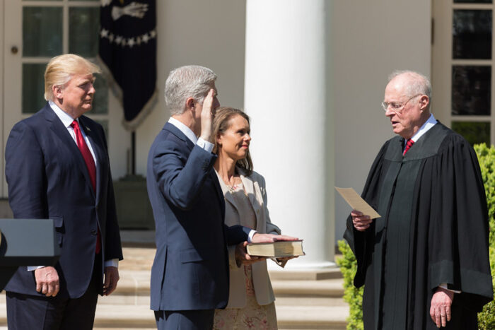 Then-Justice Anthony Kennedy swears in Neil Gorsuch as a Supreme Court justice on April 10, 2017, at the White House